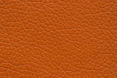 Bright orange artificial leather with large texture. stock images