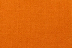 Bright orange background from textile material. Fabric with natural texture. Bright orange background from a textile material. Fabric with natural texture royalty free stock images