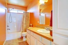 Bright orange bathroom interior Stock Image
