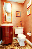 Bright orange bathroom in luxury house Royalty Free Stock Images