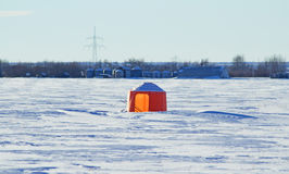 Bright orange bee shelter. In a snow covered field Stock Images