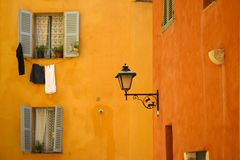 Bright orange city walls of historic grasse Royalty Free Stock Image