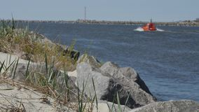 A bright orange Coastal Safety Patrol boat. A bright orange Coastal Safety Patrol boat passes port of Klaipeda stock video