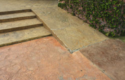 Bright orange concrete steps and ramp way for support wheelchair. Disabled person Royalty Free Stock Photography