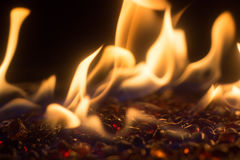 Bright Orange Fire On Red Glass Stones Stock Photography