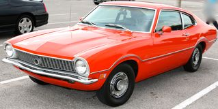 Bright Orange 1965 Ford Maverick Antique Car Stock Images