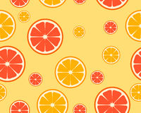 Bright orange and grapefruit background. Pieces of fruit. Vector seamless pattern Stock Photography