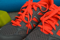 Bright orange and gray sport shoes Royalty Free Stock Photos