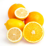 Bright orange with half a lemon Stock Photography