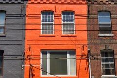 Bright orange house Stock Images