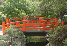Bright Orange Red Japanese Bridge at Descanso Gardens. Bright orange Japanese bridge under the shade trees at Descanso Gardens in Flintridge, California calls stock image