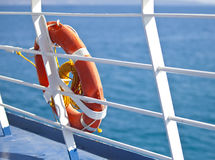 Bright orange lifebuoy on the ferry deck Stock Image