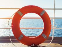 Bright, orange lifebuoy on the top deck of the cruise liner stock photos