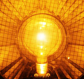Bright and orange light bulb Royalty Free Stock Photography