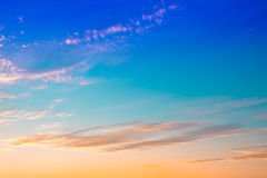 Bright orange mix blue colors sunset sky. Royalty Free Stock Photo