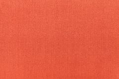 Bright orange ocher background from a textile material. Fabric with natural texture. Backdrop. Bright orange background from a textile material. Fabric with stock photos