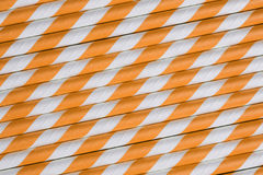 Bright orange paper straw background Stock Photography