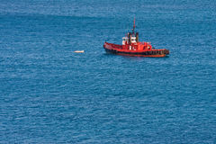 Bright Orange Pilot Boat on Blue Stock Photos