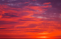 Bright orange, red and yellow colors sunset sky. Stock Photos