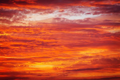 Bright orange, red and yellow colors sunset sky. Royalty Free Stock Image