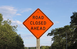 Bright orange road closed ahead sign Royalty Free Stock Image