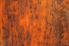 Bright orange rusty metal background. Grunge iron plate royalty free stock image