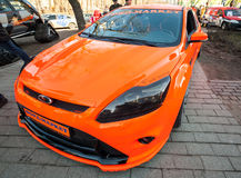 Bright orange sporty styled Ford focus car Royalty Free Stock Image