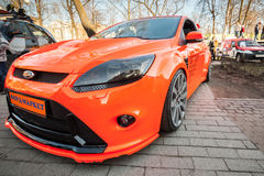 Bright orange sporty styled Ford focus car stands parked Stock Photo