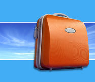 Bright orange suitcase. Against sky panorama shot. Bright blue background with room for text Royalty Free Stock Images