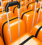 Bright orange suitcase on wheels with handle  background Royalty Free Stock Images