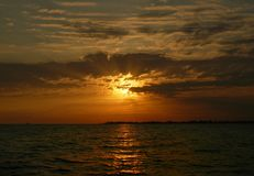 Bright orange summer sea sunset in the clouds royalty free stock photos