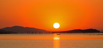 A bright orange sunset over lake caribou Stock Photography
