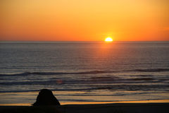 Bright orange sunset over the ocean Stock Images