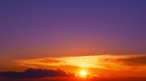 Bright orange sunset and violet sky Stock Photography