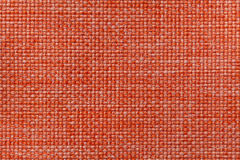 Bright orange textile background with checkered pattern, closeup. Structure of the fabric macro. Stock Photography