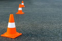 Bright orange traffic cones. On the gray asphalt Royalty Free Stock Photos
