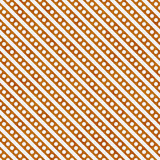 Bright Orange and White Small Polka Dots and Stripes Pattern Rep. Eat Background that is seamless and repeats Royalty Free Stock Images