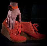 Bright orange women fashion boots and watch Royalty Free Stock Image