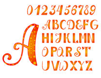Bright orange-yellow alphabet and numbers Stock Photos