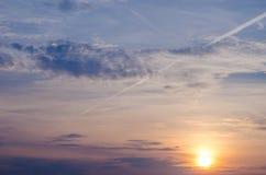 Bright orange and yellow colors sunset sky. sunset with a line by the plane. Bright orange and yellow colors sunset sky. sunset with a line by the plane Stock Photo