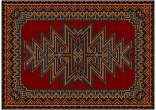Bright oriental carpet with original pattern on a red background Royalty Free Stock Image