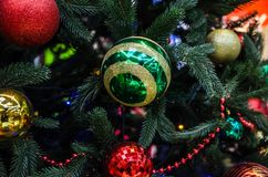 Bright ornaments on a fir tree stock images