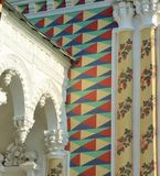 Bright ornaments and molding. Decorative elements on the walls of one of the monastery buildings. Columns, bright patterns and molding royalty free stock image