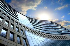 Bright outlook for business. Modern office block with sunny beautiful sky Royalty Free Stock Photos