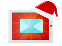 Bright pad with Santa hat and mail Stock Photos