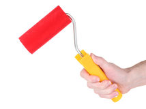 Bright paint roller in hand Stock Photo