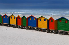 Bright Painted Beach Huts. In primary colors at Muizenberg, Cape Town Royalty Free Stock Images