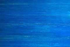 The bright painted blue wooden textured background. stock photo