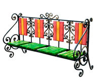 Bright painted old renovated stylish garden bench. Bright painted old renovated high quality stylish garden wooden and cast-iron bench isolated over a white stock photography