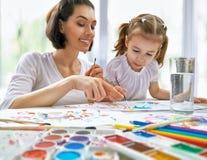 Bright paints Stock Photos